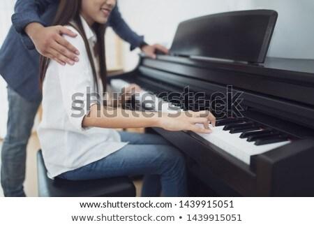 szerető · pár · játszik · zongora · szoba · otthon - stock fotó © boggy