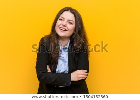 Portrait of a delighted overweight young woman Stock photo © deandrobot