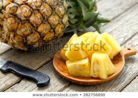 Stock photo: Sliced ripe pineapple on plate