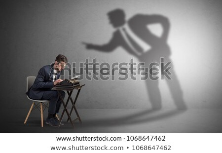 Stock photo: Man working hard and shadow arguing with him