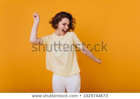 young woman or teenage girl in yellow t-shirt Stock photo © dolgachov