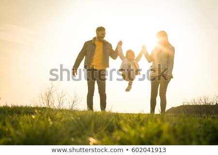 A family of two a Mother and child smile and walk in a public Park together Stock photo © ElenaBatkova
