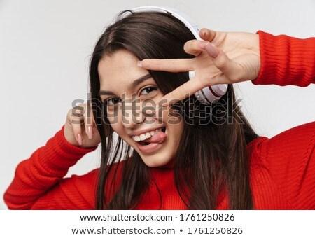 Foto sedutor alegre mulher fones de ouvido Foto stock © deandrobot