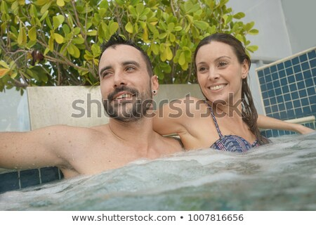 Fiatal nő megnyugtató jacuzzi tető hotel élvezi Stock fotó © GVS