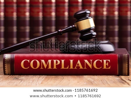 Foto stock: Judge Gavel And Soundboard On Compliance Book