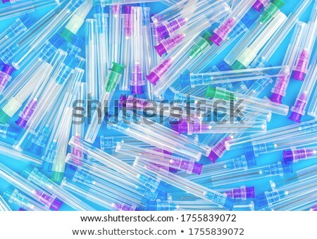 Medical pattern from plastic multicolored disposable syrenges. Stock photo © artjazz