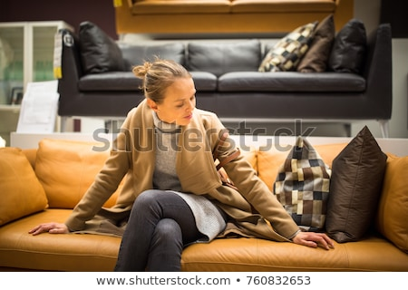 Pretty, young woman choosing the right pillow for her apartment  Stock photo © lightpoet