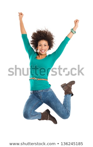 Exuberant young woman jumping for joy Stock photo © Giulio_Fornasar