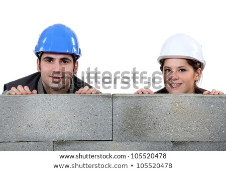 Tradespeople hiding behind cinder blocks Stock photo © photography33