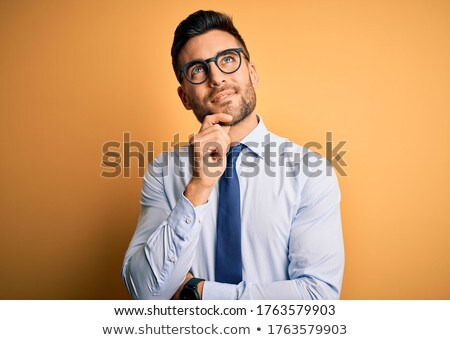 Handsome businessman smiling at camera with arms crossed Stock photo © wavebreak_media