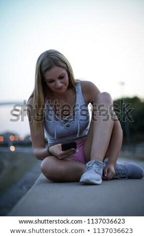 fitness · runner · dziewczyna · muzyki · telefonu · komórkowego · app - zdjęcia stock © chesterf
