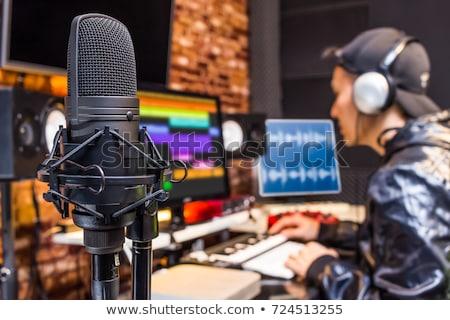 man with headphones at music recording studio Stock photo © dolgachov