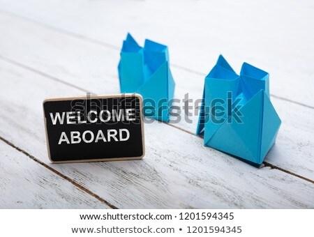 Közelkép üdvözlet szöveg fából készült asztal papír Stock fotó © AndreyPopov