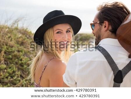 человека соломенной шляпе пляж закат улыбается Сток-фото © Lopolo