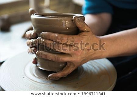Earthenware makers Stock photo © pressmaster