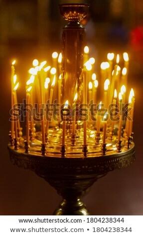 Ardente velas católico igreja brilhante vermelho Foto stock © vapi