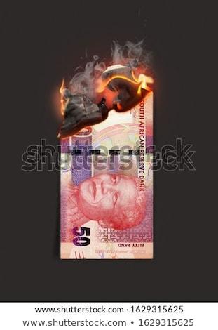 Rand Note Burning Stock photo © albund