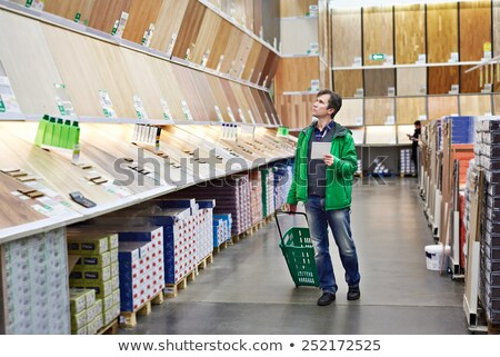 Woodworker standing with laminate flooring Stock photo © photography33