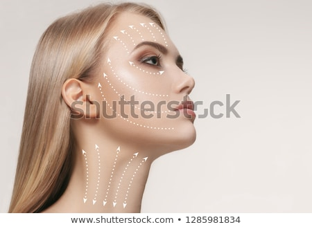 Beautiful girl with facial arrows on her skin Stock photo © ra2studio