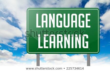 Linguagem aprendizagem verde rodovia poste de sinalização estrada Foto stock © tashatuvango