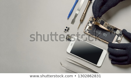 dismantle the phone and tweezers with a chip Stock photo © OleksandrO