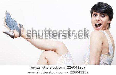 Slim young lady addicted to luxury shoes Stock photo © konradbak