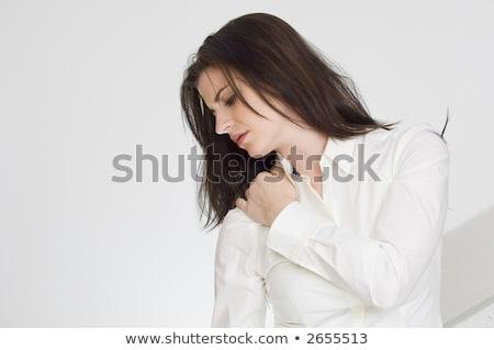 Pretty brunette with a sore neck Stock photo © wavebreak_media