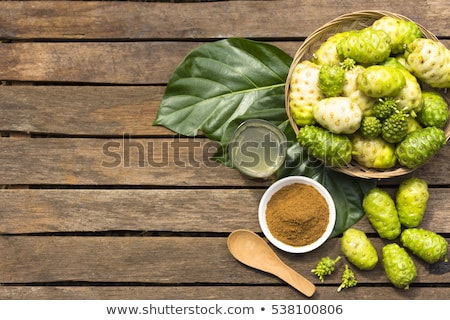 Noni fruit  and noni juice with noni powder on wooden table.Fruit for health and herb for health.10 stock photo © Bigbubblebee99