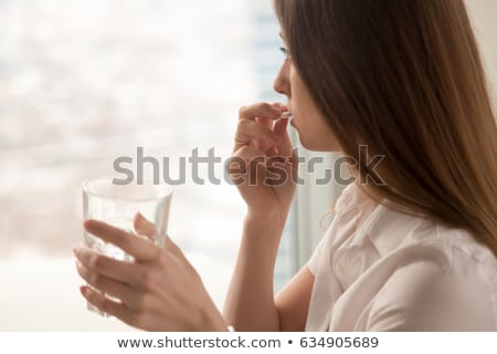 Young woman with headache, migraine take pill stock photo © CandyboxPhoto