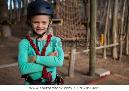 Portrait of little girl wearing helmet in the forest Stock photo © wavebreak_media