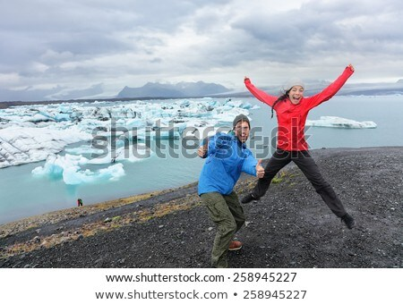 Jovem turista saltando lago Islândia homem Foto stock © Lopolo