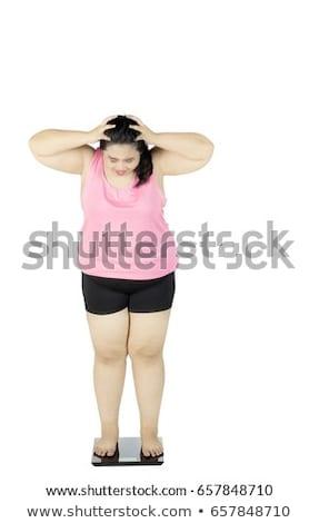 Retrato chateado excesso de peso mulher jovem esportes Foto stock © deandrobot