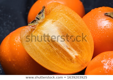 Fresh ripe persimmon on cutting board Stock photo © furmanphoto