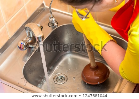 Plumber Using Plunger For Cleaning Kitchen Sink Stock photo © AndreyPopov