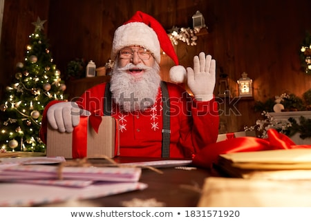 Bearded Old Man Santa Claus Wishes Merry Christmas Stock photo © robuart