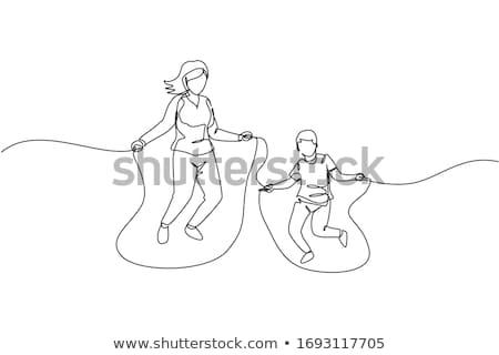 Mom and son jumping in the park Stock fotó © galitskaya