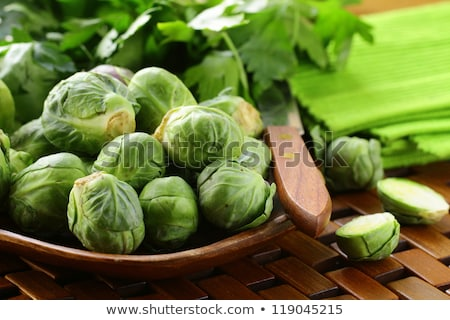 Fresh raw brussels sprouts on a wooden table Stock photo © Melnyk