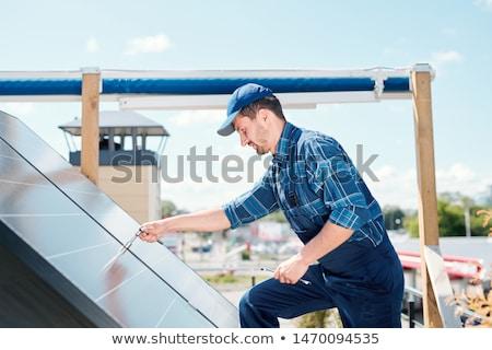 Fiatal technikus mester munkaruha görbület napelem Stock fotó © pressmaster