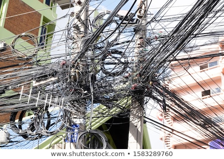 Messy wires attached to the electric pole, the chaos of cables and wires on an electric pole concept Stock photo © galitskaya