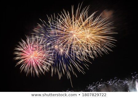 Foto stock: Bright Colourful Fireworks Filling The Night Sky