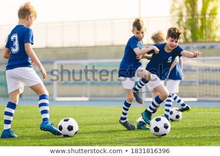 Iskola gyerekek képzés futball pálya csoport Stock fotó © matimix