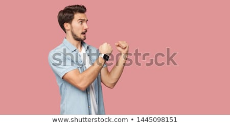 angry young man ready for fist punch Stock photo © dolgachov