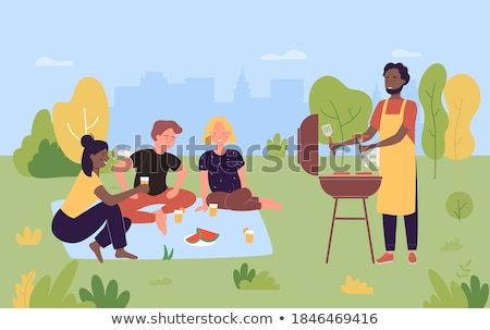 Man on Picnic in City Park Grill Sausages on Barbecue Stock photo © robuart