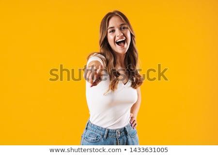оптимистичный молодые удивительный женщину указывая фото Сток-фото © deandrobot