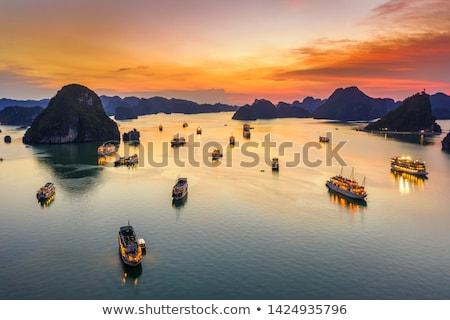 Dawn on the background of the Vietnamese islands Stock photo © galitskaya