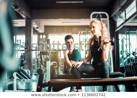 Bicep curl anaerobic exercise young fitness woman Stock photo © darrinhenry