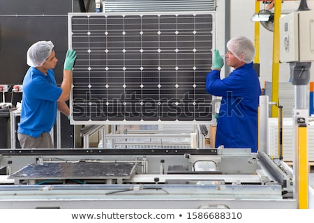 Assembly of solar panels stock photo © visdia