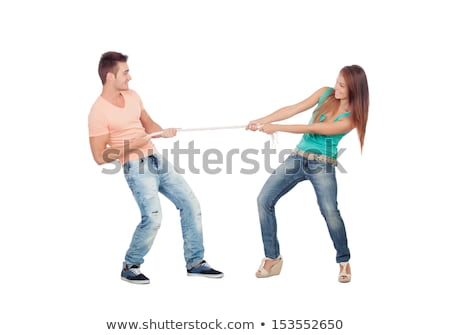 happy smiling couples pulling a rope stock photo © get4net