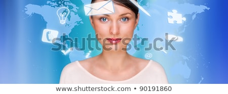 Stock photo: A businesswoman with icons floating around her head. Portrait of