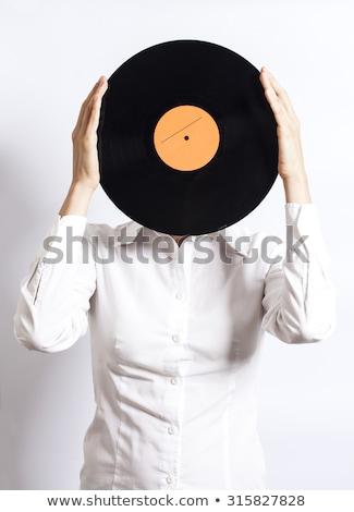 girl dj holding a lp over the head Stock photo © goce